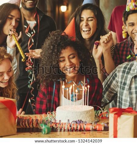 Portrait of happy friends celebrating afro-american girl's birthday