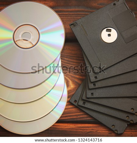 Floppy disks and disks on wooden background #1324143716