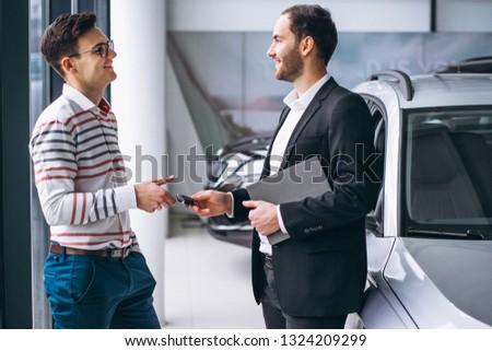 Man buying a car #1324209299