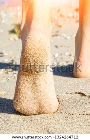 Beautiful traces with feet on sea nature background #1324264712