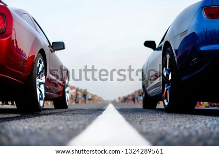 cars at the start, competitions, powerful cars, unlim 500, dragracing, red and blue auto at the start, a crowd of fans, muscle cars ready for dragrace,street car racers #1324289561