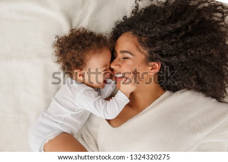 Love of a mother and baby. Family in the house. Lifestyle Royalty-Free Stock Photo #1324320275