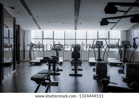 Modern light gym. Sports equipment in gym. Barbells of different weight on rack. #1324444511