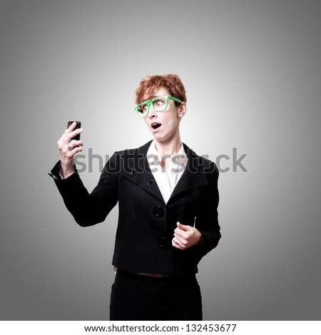 surprised business woman with phone on gray background #132453677