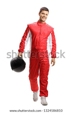Full length portrait of a male car racer holding a helmet and walking towards the camera isolated on white background Royalty-Free Stock Photo #1324586810