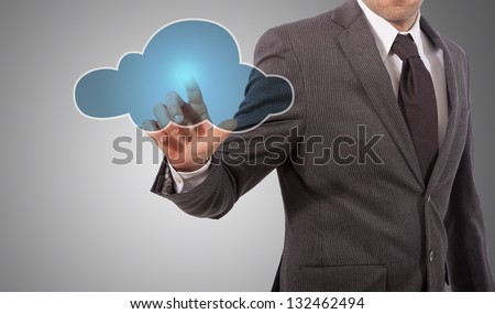 business man touching cloud on screen, grey background #132462494