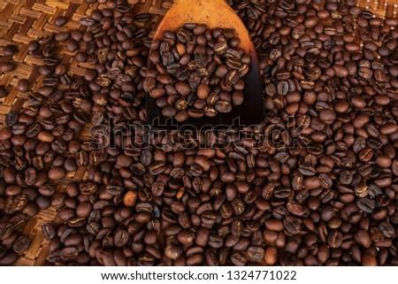 Roasted coffee beans in threshing basket  #1324771022