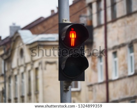 Red light signal for pedestrians on the street #1324899359