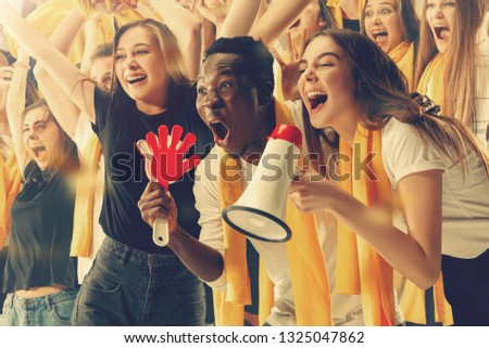 Group of happy fans are cheering for their team victory #1325047862