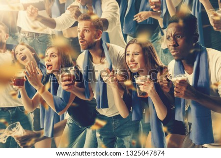 Group of happy fans are cheering for their team victory #1325047874
