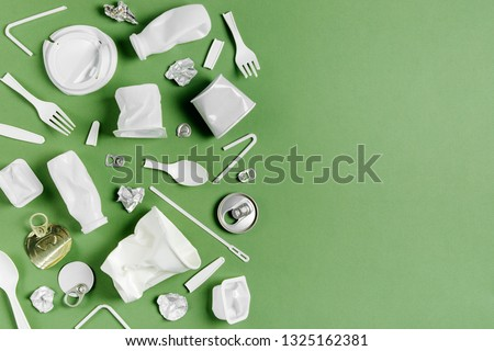Plastic waste collection on  green background. Concept of Recycling plastic and ecology. Flat lay, top view #1325162381
