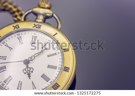 Time management concept : Vintage / retro pocket watch / clock on black table, depicts process of planning, exercising conscious control of time to increase effectiveness, efficiency and productivity #1325172275