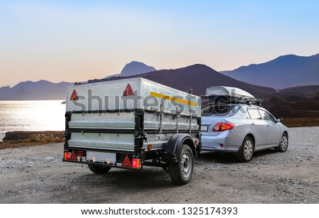 Car trailer and roof rack by the sea #1325174393