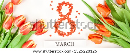 Creative flat lay top view 8 March International Women's Day greeting card with red tulips spring flowers on white background. Celebration banner template #1325228126
