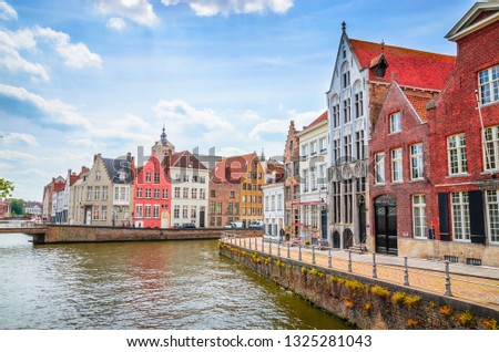 Beautiful canal and traditional houses in the old town of Bruges (Brugge), Belgium #1325281043