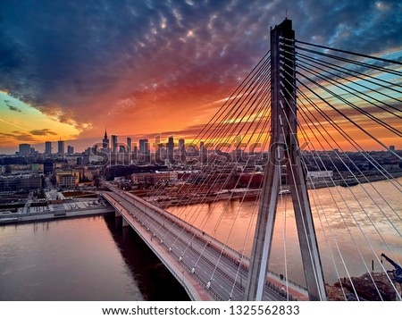 Beautiful panoramic aerial drone sunset view to Warsaw city center with skyscrapers and Swietokrzyski Bridge (En: Holy Cross Bridge) - is a cable-stayed bridge over the Vistula river in Warsaw, Poland #1325562833