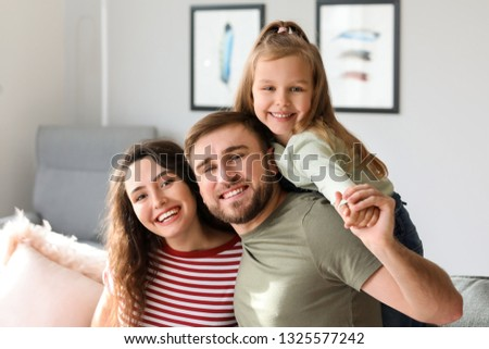 Portrait of happy family at home #1325577242