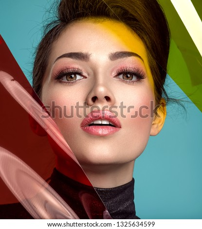 Beautiful fashion woman with  a colored  items.  Attractive white girl with  coral color lipstick. Glamour fashion model with bright gloss make-up posing at studio. Stylish fashionable concept. Art.  #1325634599