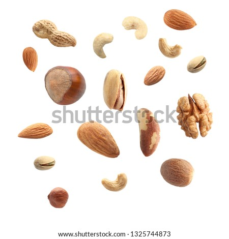 Falling nuts on white background #1325744873