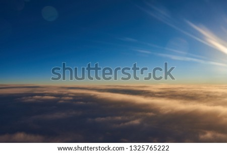 blue sky over fluffy clouds #1325765222