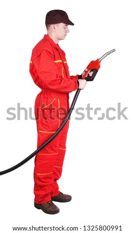Man gas station staff  is holding red gasoline pistol pump fuel nozzle #1325800991