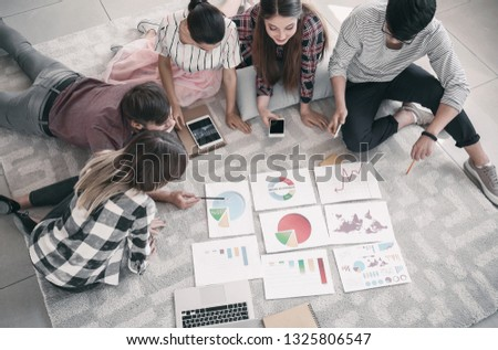 Young people having business meeting in office #1325806547