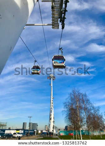 London, London / United Kingdom - February 3 2019: Emirates Air Line cable cars with clear blue sky #1325813762