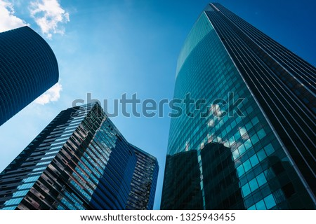 View of Moscow-City skyscrapers. Moscow-City is an office buildings with futuristic design. Architecture landmark of Moscow. Amazing modern constructions against summer blue sky. #1325943455