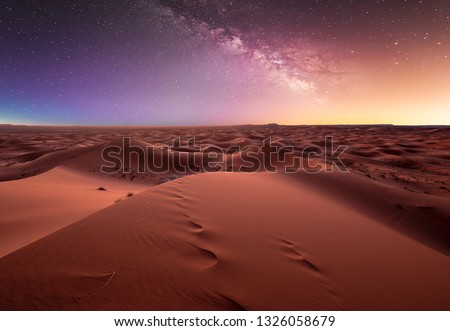 Amazing milky way over the dunes Erg Chebbi in the Sahara desert near Merzouga, Morocco , Africa. Beautiful sand landscape with stunning sky full of stars and night under a starry sky. After sunset. Royalty-Free Stock Photo #1326058679