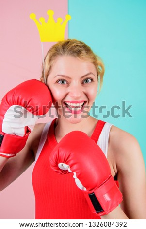 Athletic princess. Funny woman with crown prop in boxing gloves. Cute boxer girl with party prop. Athletic woman in sports wear. Sportswoman with princess look. Boxing is fun for her. #1326084392