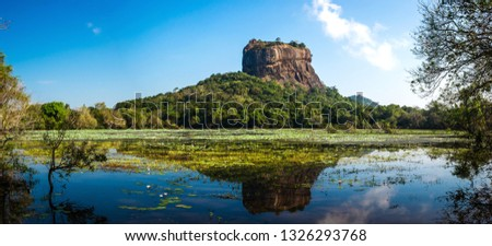 Panoramic picture of Sigiriya Rock Fortress, (a UNESCO world heritage Site) seen from Sigiriya Lake in the cultural triangle of Sri Lanka, Asia