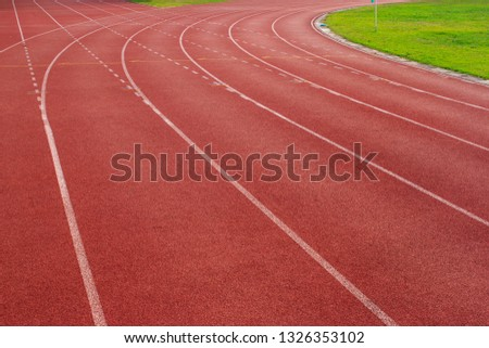 Red running track Synthetic rubber on the athletic stadium #1326353102