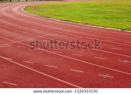 Red running track Synthetic rubber on the athletic stadium #1326353150