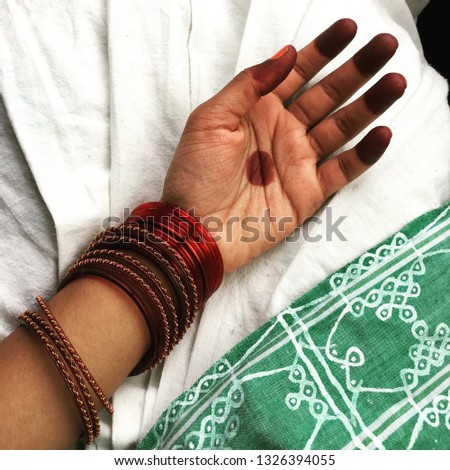 Moon in my palm: artistry not palmistry. Traditional South Indian mehandi or henna, red bangles and a saree with traditional South Indian design #1326394055