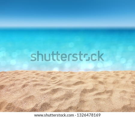 beautiful sandy beach with blur ocean background summer concept #1326478169