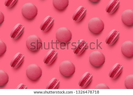 Macaroons on colored background, a pattern of colorful french cookies macarons. Beige, brown french cookies macarons on red background. Gift for Valentine's Day #1326478718