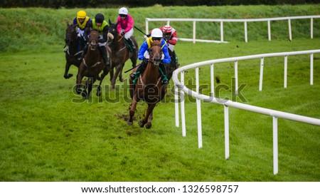 Winning Race horse and jockey taking the lead on the final furlongs of the race #1326598757