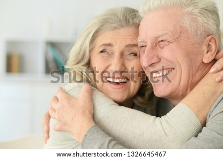 Portrait of cute happy senior couple posing at home #1326645467