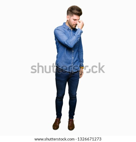 Young handsome blond man wearing casual denim shirt tired rubbing nose and eyes feeling fatigue and headache. Stress and frustration concept. #1326671273