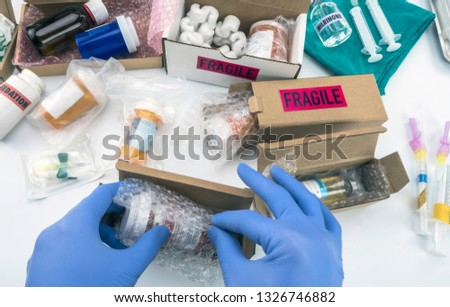 Nurse unpacking medication in boxes, conceptual image, horizontal composition  #1326746882