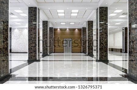 Marble interior of luxury lobby of commercial building or hotel. Clean corporate hall with real floor tile. Shiny floor with reflections in modern office after professional cleaning service. Royalty-Free Stock Photo #1326795371