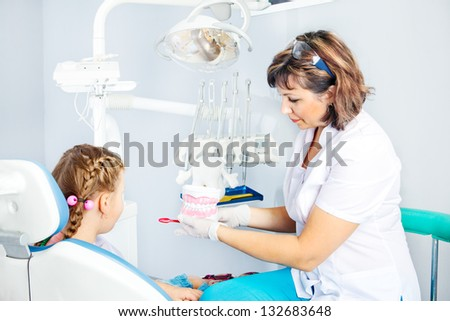 Pediatric dentist showing artificial toy denture #132683648