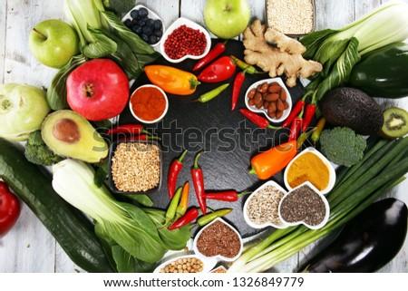 Healthy food clean eating selection. fruit, vegetable, seeds, superfood, cereals, leaf vegetable. veggie or vegan food #1326849779
