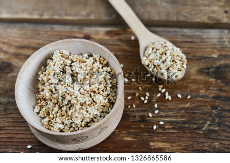 white sesame seed, sesame seed in wooden Cup on natural wooden background in rustic style #1326865586