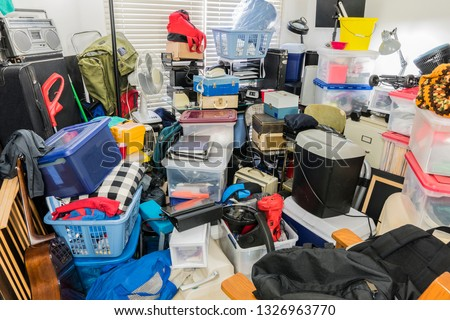 Hoarder room packed with stored boxes, electronics, files, business equipment and household items. #1326963770