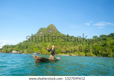 Semporna, Sabah, Malaysia-Dec 01, 2018: Unidentified beautiful young girl of Borneo sea gypsy ethnic act for pose to the camera at the Bodgaya island in Semporna, Sabah, #1327049612