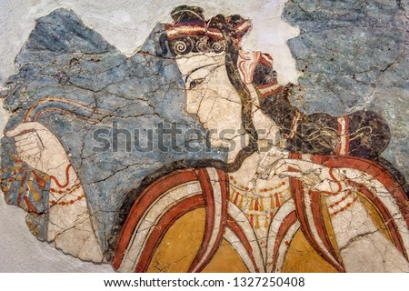 Ancient Greek fresco of woman. Remains of the culture of ancient civilization in Greece. Beautiful antique wall painting, old Greek art. Cracked mural close-up.