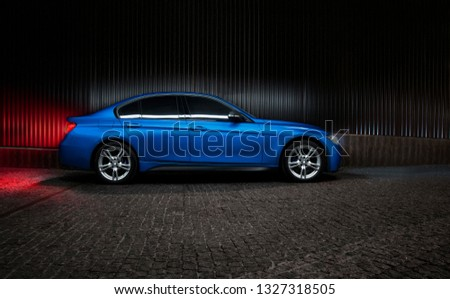 Powerful beast sedan in blue color, with carbon fiber Royalty-Free Stock Photo #1327318505