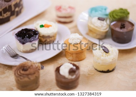 Cupcakes. Colorful cupcakes for takeaway with soft focus on the Thai tea cupcake. #1327384319