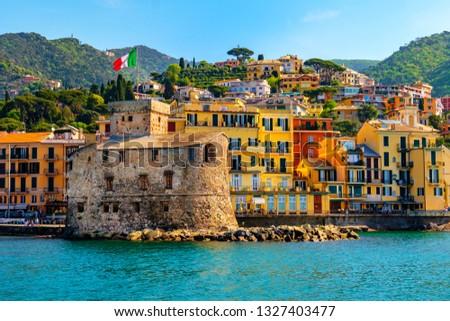 italian castle by the sea Castello di Rapallo in the italian riviera Portofino area - Genova - Liguria - Italy . Royalty-Free Stock Photo #1327403477